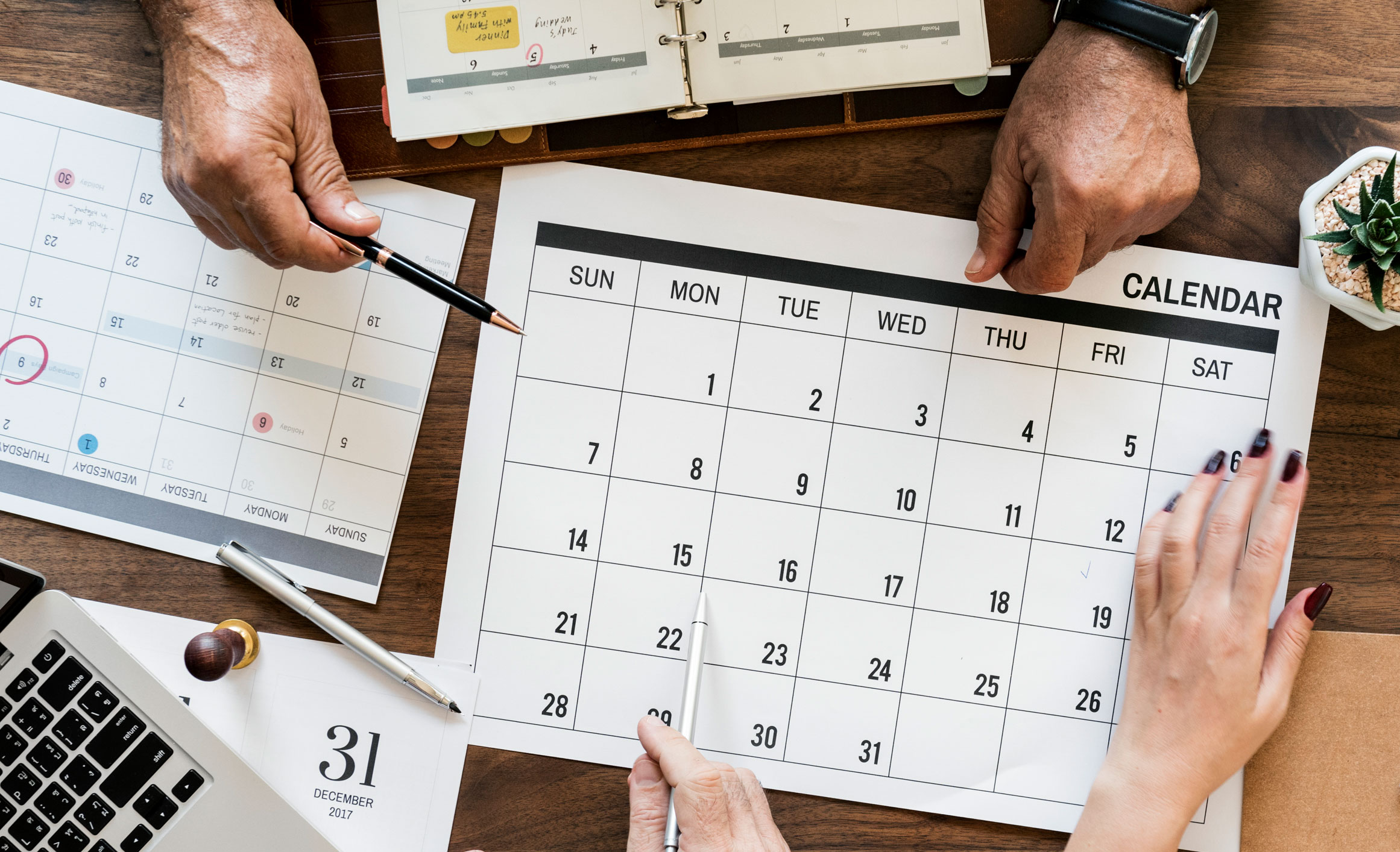 Image of hands and calendars