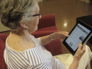 Older woman at North Hill senior living using iPad.