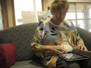 A senior at North Hill retirement community uses an iPad after joining the iPad club