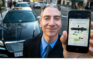 older uber driver with app - Photo Credit Paul J. Richards-APP-Getty