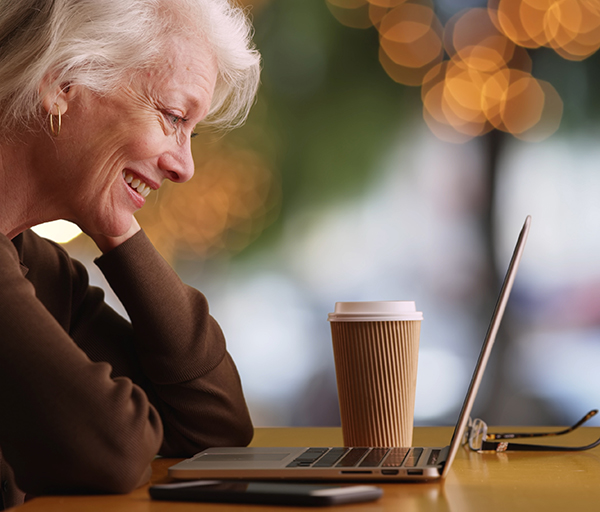 Senior woman taking class on computer